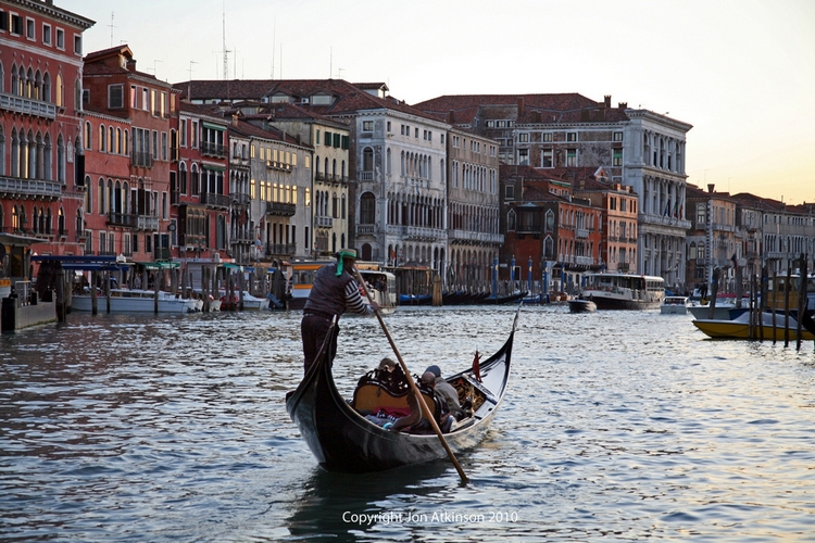 Gondolier on the Grand Canal, Venice, Italy
