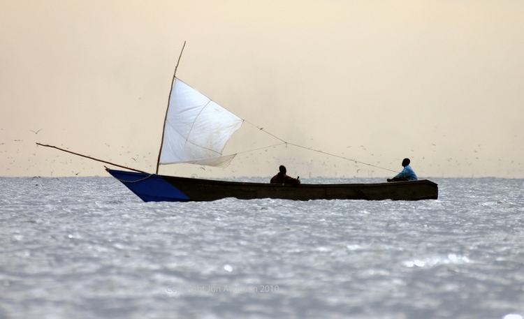 "Boat tries to evade ""Lake Flies"" on Lake Victoria, Tanzania"