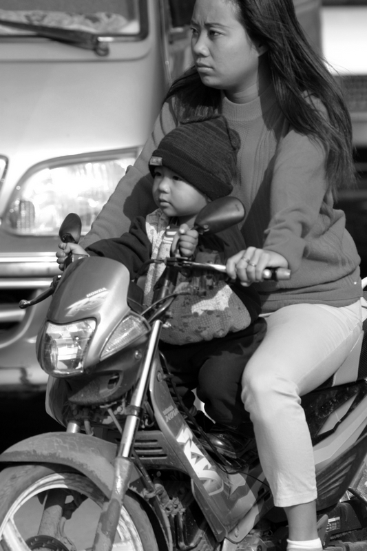Women and child on motorbike in Phnom Penh