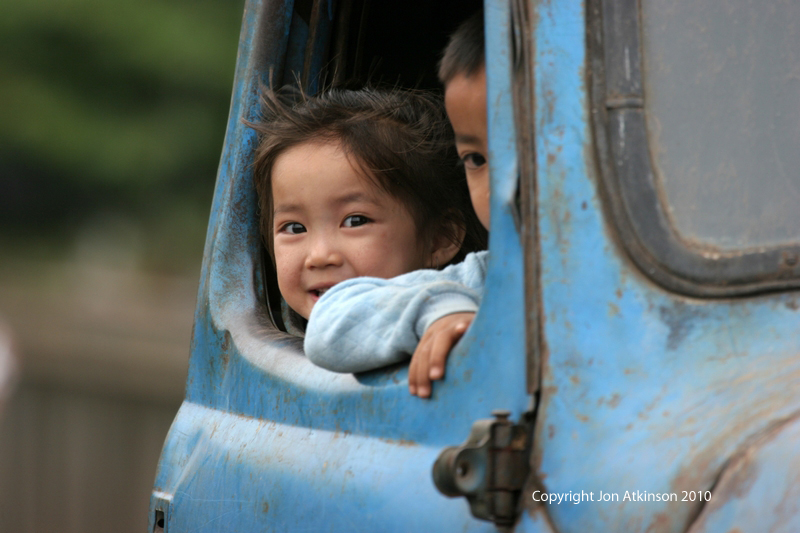 Children in Car, Laos Road Scene